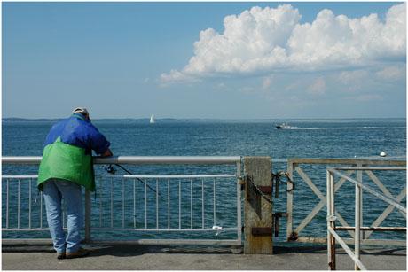 BLOG-DSC_2531-pêcheur Eyrac face Tchanquées et presqu'île