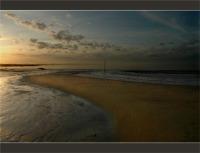 voir les reflets or sur la plage
