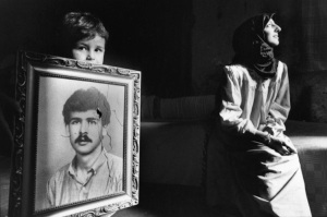 Samer Mohdad - War Children, Lebanon 1985-1992 An orphan shows the portrait of his killed father, Beirut, Lebanon, 1989